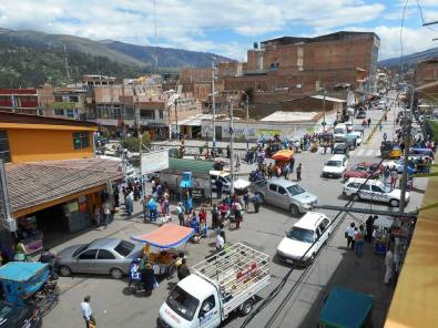 View of the busy street next to the market from Hostal Akilpo roof terrace